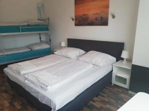 A bed or beds in a room at The Hostel