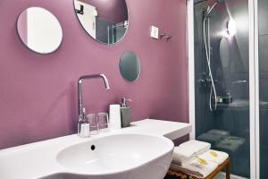Ein Badezimmer in der Unterkunft Apartments and Rooms Meščanka