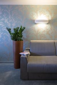 Ein Sitzbereich in der Unterkunft Hotel Albona Nova
