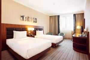 Łóżko lub łóżka w pokoju w obiekcie Hilton Garden Inn Rzeszów
