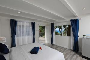 A bed or beds in a room at Kata White Villas