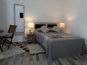 A bed or beds in a room at Hello Guest House