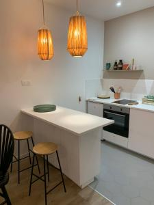 A kitchen or kitchenette at Le Saint Victor