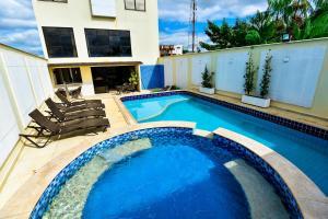 The swimming pool at or near Nobile Suites Gran Lumni