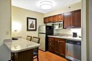 A kitchen or kitchenette at Homewood Suites Durham-Chapel Hill I-40