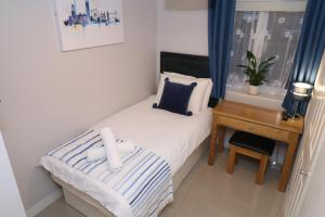 A bed or beds in a room at The Lavenders