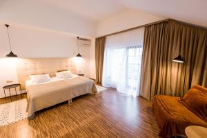 A bed or beds in a room at Veselyj Zajets