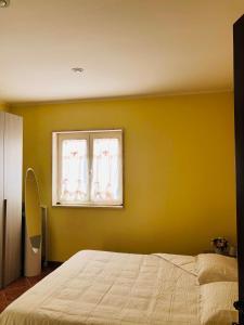 A bed or beds in a room at La villetta senza tempo