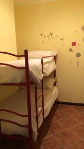 A bunk bed or bunk beds in a room at La villetta senza tempo