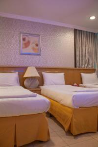 Cama ou camas em um quarto em Sadan Plaza