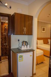 A cozinha ou cozinha compacta de Sadan Plaza