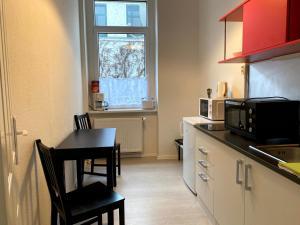 A kitchen or kitchenette at Deutscher Hof