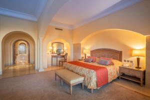 A bed or beds in a room at Hasdrubal Prestige Djerba