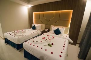 Cama ou camas em um quarto em Mora Hotel