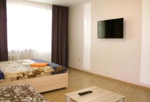 Кровать или кровати в номере Норд Сити на Сысольском шоссе, 19