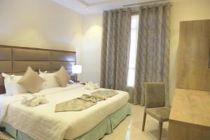 Cama ou camas em um quarto em La Fontaine Noble Suites