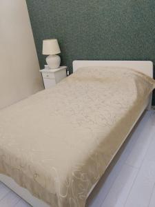 Кровать или кровати в номере Апарт-отель ApartSochi