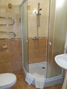 Ванная комната в Hotel Guamka