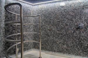 Ванна кімната в Grand Hotel Roxolana