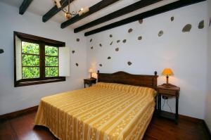 A bed or beds in a room at Finca la Crucita Haria Lanzarote