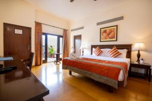 A bed or beds in a room at Fort JadhavGADH -A GADH Heritage Hotel