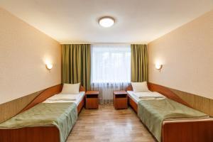 Кровать или кровати в номере Санаторий Малые Соли