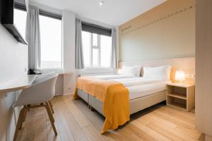 A bed or beds in a room at Reykjavik Lights Hotel by Keahotels