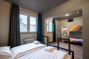 A bed or beds in a room at a&o Hamburg Reeperbahn