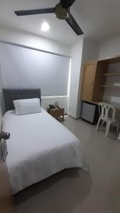 Un ou plusieurs lits dans un hébergement de l'établissement Onoma Hotel