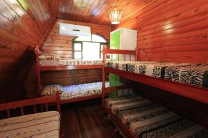 A bunk bed or bunk beds in a room at Hostel Chalé da Praia