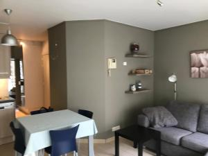 A seating area at Appartement Koksijde