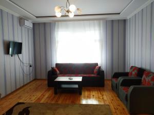 Uma área de estar em Qafqaz Four Seasons Villa Gabala