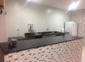 A kitchen or kitchenette at Casa Temporada em Maria Farinha