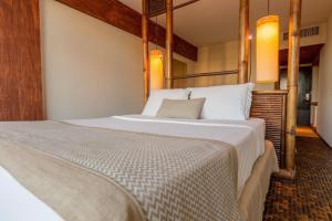 A bed or beds in a room at Ritz Lagoa da Anta Hotel & SPA