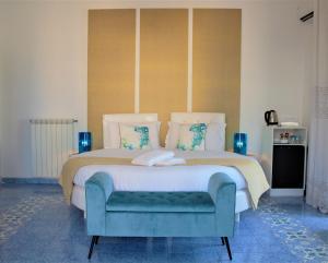 Un ou plusieurs lits dans un hébergement de l'établissement Piazza Tasso B&B Relais