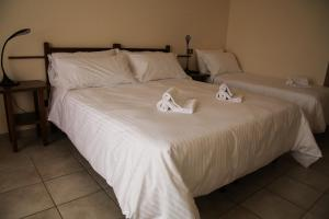 A bed or beds in a room at Albergo Parco Gran Sasso
