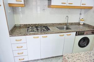 A kitchen or kitchenette at Vivienda de uso turístico Alma da Costa da Morte