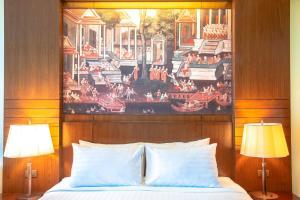 เตียงในห้องที่ SYLVAN Koh Chang