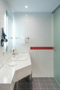 A bathroom at Park Inn by Radisson Hotel Astana