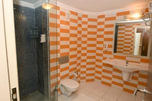 Een badkamer bij Yelken Mandalinci Spa&Wellness Hotel