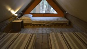 A bed or beds in a room at Camping Lido Verbano
