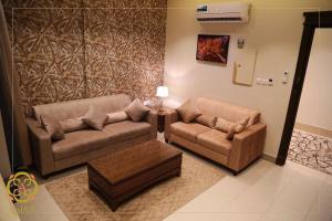 Uma área de estar em Arcadia Hotel Suites Yarmouk
