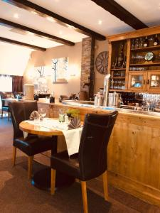 A restaurant or other place to eat at Hotel - Restaurant - Cafe- Geertien