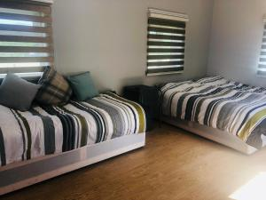 A bed or beds in a room at Elmcroft Guest House
