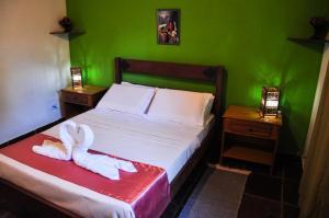 Cama ou camas em um quarto em Castelar da Alvorada