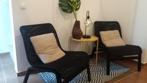 A seating area at CASA ALEGRIA - Cottage Lagos -