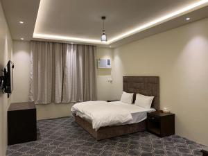 Cama ou camas em um quarto em Radiha Hotel Suites