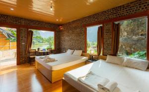 A bed or beds in a room at Hàm Rồng Homestay Ninh Bình