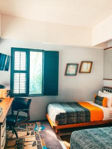 A bed or beds in a room at Kosenda Hotel