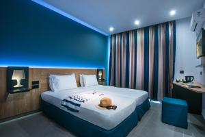 A bed or beds in a room at Infinity Blue Boutique Hotel & Spa - Adults Only
